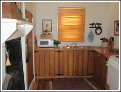 Fully equipped kitchen with microwave and electric stove